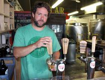 Black Swan Brewing Co. owner Ryan Stokes pours a beer inside the taproom on Friday, Aug. 18, 2017 in Stratford, Ont. Stokes, a 40-year-old Stratford resident, is now the sole owner after business partner Bruce Pepper decided to leave the company this summer to return to teaching. (Terry Bridge/Stratford Beacon Herald)