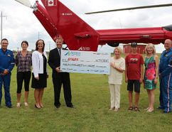 Access Credit Union donated $250,000 to STARS on August 16. (Pictured: Flight Paramedic Grant Therrien, STARS user Amanda Legault, ACU Senior Vice President and Chief Operating Officer Myrna Wiebe, ACU President and CEO Larry Davey, STARS President and Chief Executive Officer Andrea Robertson, STARS user Cohen Hildebrand, MP for Portage-Lisgar Candice Bergen, Pilot Jason Johnson)