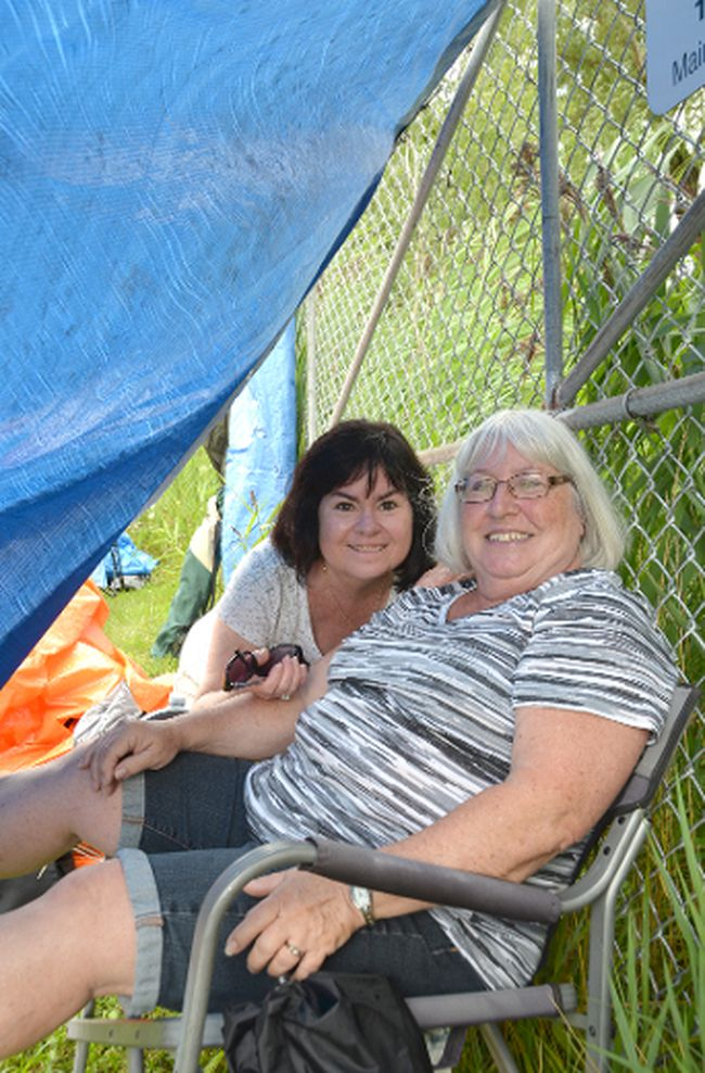 Mary Specht, right, and Catherine Lazette at the front of the lineup at Summerfolk 42 at Kelso Beach Park in Owen Sound on Friday. (Rob Gowan The Sun Times)