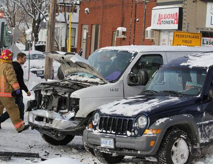 Firefighters respond to crash at Gore and Albert streets in December 2016.
