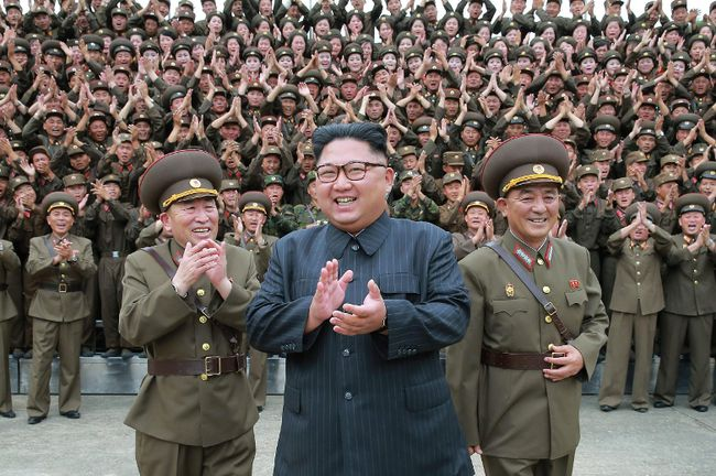 North Korean leader Kim Jong-un acknowledges a welcome from military officers during his visit to Korean People's Army's Strategic Forces in North Korea.  (Korean Central News Agency via AP)