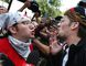 """A counterprotester (left) confronts a professed supporter of President Donald Trump at a """"Free Speech"""" rally by conservative activists on Boston Common, Saturday, Aug. 19, 2017. (Michael Dwyer/AP Photo)"""
