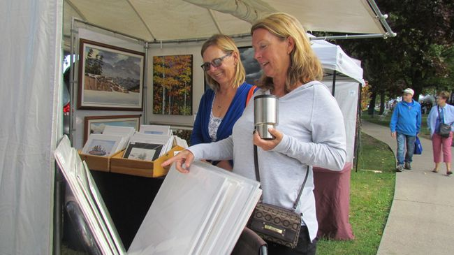 Karlene Shaw, right, and Anita Ollett of Bright's Grove check out an artist's booth Saturday at Artzscape by the Bay at Centennial Park in Sarnia, Ont. The fundraiser for the Pathways Health Centre for Children continued Sunday.