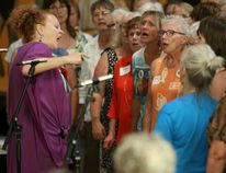 Georgette Fry (far left) sings along with the combined choirs of Picton, Kingston and Brockville during the 15th anniversary party for Shout Sister! on Saturday August 19, 2017 in Belleville, Ont. Tim Miller/Belleville Intelligencer/Postmedia Network