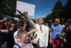 Brian Ruhe gives a Nazi salute as alt-right protesters and anti-racism protesters take part in rallies at City Hall in Vancouver, B.C., on Saturday, August 19, 2017. THE CANADIAN PRESS/Darryl Dyck