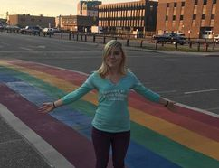 Sam Wells poses for a photo at the Pride crosswalk spanning Hardin Street near the corner with Biggs Avenue in downtown Fort McMurray, Alta. Supplied Image/Theresa Wells