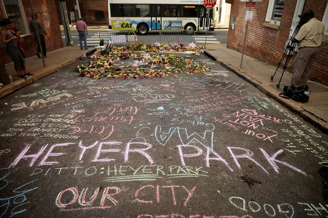 A chalk message calling for a park to be renamed after Heather Heyer is written on the street where she was killed and 19 others injured when a car slammed into a crowd of people protesting against a white supremacist rally in Charlottesville, Va., on Aug. 16, 2017. (Chip Somodevilla/Getty Images)
