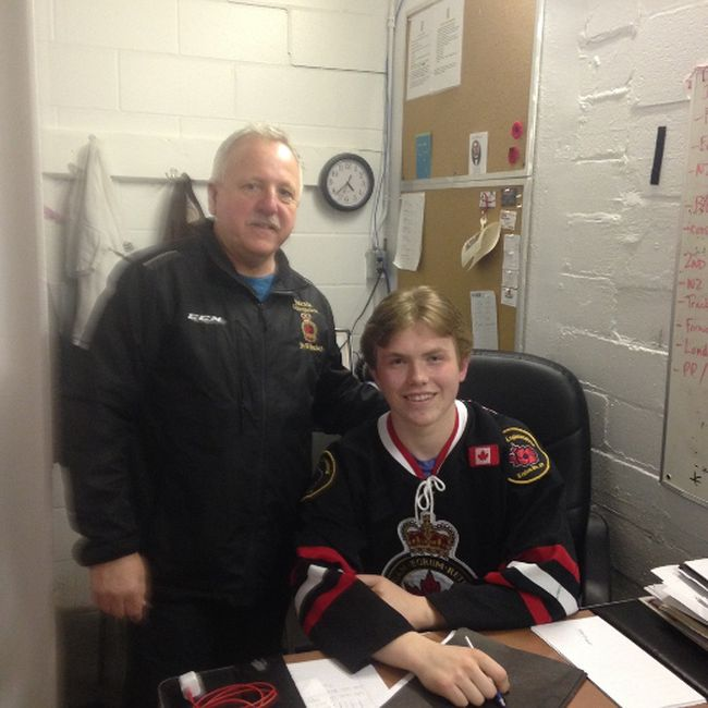 Rookie Aaron Jamieson, seated, is expected to crack the Sarnia Legionnaires lineup this winter. Shown with him is head coach Mark Davis. (Submitted photo)