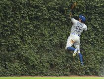 Kevin Pillar #11 of the Toronto Blue Jays fields a fly ball off the center field wall during the eighth inning of a game against the Chicago Cubs at Wrigley Field on August 20, 2017 in Chicago, Illinois. (Stacy Revere/Getty Images)