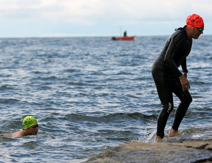 Participants exit Lake Ontario at the first Swim for Kids fundraising event at Richardson Beach on Saturday. (Steph Crosier/The Whig-Standard)
