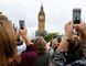 People record the last bell bong at Elizabeth Tower in London, Monday, Aug. 21, 2017. (AP Photo/Frank Augstein)