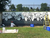 """Aida Sulcs works on her piece for the """"On the Wall"""" street art festival Monday morning. (Peter Hendra/The Whig-Standard)"""