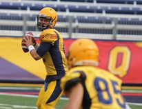 Queen's Golden Gaels quarterback Kyle Gouveia looks for Connor Weir during the second half of an exhibition university football game against the McGill Redmen at Richardson Stadium on Saturday. Queen's won 38-24. (Steph Crosier/The Whig-Standard)