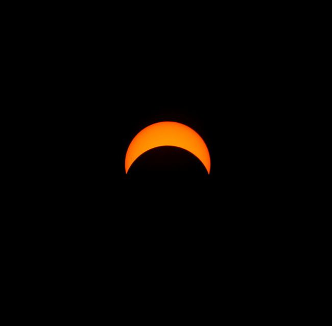 The moon reaches its peak coverage of the sun during Monday's solar eclipse, as seen from Kingston, Ont. on Monday, Aug. 21, 2017. 