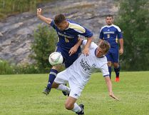 John Lappa/Sudbury Star Ayden Meilleur, left, of Laurentian Vees, and a Bradford FC Porto Dragon Force U17 player battle for the ball during exhibition action at Laurentian University on Friday.