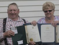 John and Mabel Baxter hold up their certificates recognizing their contributions for volunteering to help seniors (Joseph Quigley | Whitecourt Star).