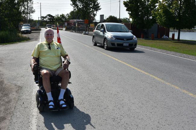 Evelyn McLeod/For The Intelligencer Bert Greenhalgh, a 95-year-old veteran of the Second World War, uses his wheelchair to get around Campbellford. While most drivers are courteous, Greenhalgh has had a couple of near misses and is urging motorists to be aware of people using wheelchairs, scooters and walkers.