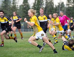 Banff Bear Jack Macree runs to score with the ball leaving Hornets in his wake as teammates back him up during the final home game against the Calgary Hornets at the Banff Rec Grounds on Saturday, Aug. 19, 2017. photo by Pam Doyle