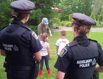 In this Facebook picture, Waterloo Regional Police officers take part in a community outreach event in a local park on August 23, 2017 in the Kitchener-Waterloo Region in Ontario. (Facebook/Waterloo Regional Police)