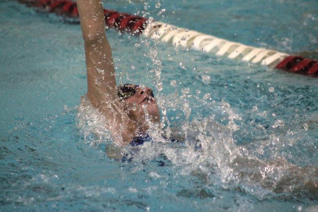 The Blue Dolphins' Samia Davidson (pictured) practices her backstroke in anticipation of the provincial finals in Edmonton Aug. 18 to 19 (Jeremy Appel | Whitecourt Star).