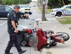 London police investigate after a man was taken to hospital after his motorcycle and a van collided at Hale and Brydges streets Thursday morning. (DALE CARRUTHERS, The London Free Press)