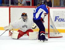 Sydney Dagenais, from Timmins, fires a shot just wide of Alyssa Desgagne, from Sault Ste. Marie, at McIntyre Arena.