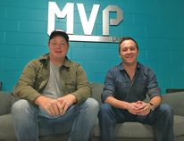 Mitch Bennet, 21, left, and Derek Lamoureux, 22, from Strathroy-Caradoc sit in Western University's MVP lab. They are the co-founders of We're Weddings, a tech company that connects brides to wedding vendors. JONATHAN JUHA/STRATHROY AGE DISPATCH/POSTMEDIA NETWORK