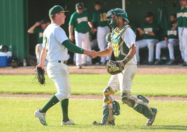 Catcher Mike Falkins congratulates pitcher Cody McElroy after the A's won Game 3 of their semifinal series over Edmonton 5-0. Photo Courtesy Two Point Photography