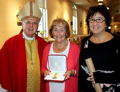 <p>Archbishop Terrence Prendergast with Francoise and Joanne Bryan on Thursday August 24, 2017 in Cornwall, Ont. Gordon Bryan was honoured with the Decoration of Honour, however was unable to attend the service due to illness. </p><p> Lois Ann Baker/Cornwall Standard-Freeholder/Postmedia Network