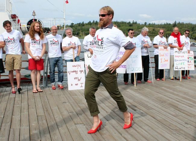 Jacob Jesweit demonstrates the best way to walk in high heels at the fourth annual Walk A Mile In Her Shoes event in support of the Kenora Sexual Assault Centre on Wednesday, Aug. 23. More than $7,464 was raised in support of the centre.