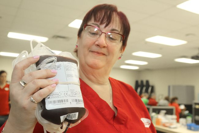 Phlebotomist Marianne McIlroy holds up a donated unit of blood at a Canadian Blood Services donor clinic in Stratford in this Beacon Herald file photo.