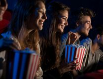 In this stock photo, moviegoers eat popcorn as they watch a film in a movie theatre. (Getty Images)