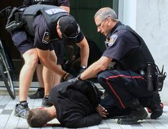 Police arrested a man on Market Lane, between Dundas Street and Covent Market Place, in downtown London Friday. Another man was also arrested nearby. (DALE CARRUTHERS, The London Free Press)