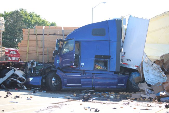 This July crash on Highway 402, which left two occupants of the truck with minor injuries, is one of three recent collisions that have raised concerns. (Postmedia Network file photo)