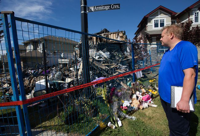 Cordell Brown looks at what is left of his home at 1040 Armitage Cres. SW in Edmonton, Friday Aug. 25, 2017. Brown's five-month-old son died in hospital after fire crews pulled the baby and his mom, Angie Tang, from the second floor of the burning home around 4 a.m. Tuesday. Photo by David Bloom