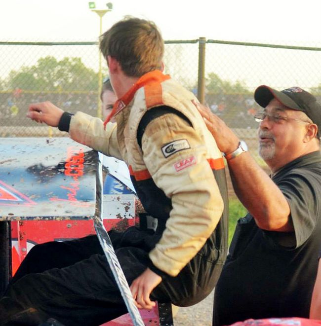 Pete Cosco, right, helps grandson Jordan Cosco out of Sportsman race car in this file photo. Pete Cosco, who along with wife Linda purchased New Humberstone Speedwayin 2004, died of a brain aneurysm at age 60 in August 2014.