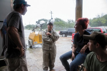 Port Lavaca Police Chief Colin Rangnow, middle, speaks with Jason January, left, Autumn Patterson and Kyle Parker, advising the residents to evacuate, Friday, Aug. 25, 2017. (Ana Ramirez/The Victoria Advocate via AP)