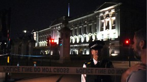 A police cordon outside Buckingham Palace where a man has been arrested after an incident, in London, Friday Aug. 25, 2017.(Lauren Hurley/PA via AP)