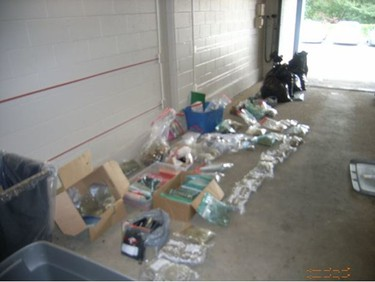 Cops seized an assortment of drugs and equipment used in the production of narcotics while executing search warrants in the city's west end on Thursday, Aug. 24, 2017. (photos supplied by Toronto Police)