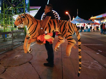Hello there Tiger - another winner -as the 138th annual edition of the CNE is mid-fair and nighttime is the best for the rides, people watching and the Midway concerts on Friday August 25, 2017. Jack Boland/Toronto Sun/Postmedia Network