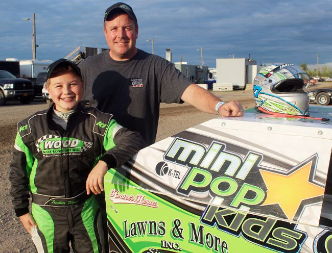 Tucker Wood, left, and father Brett in the Mod Lites pit area at Merrittville Speedway in Thorold. Though only 12, Tucker is an old hat when it comes to racing. He began competing in karts as a four-year-old.