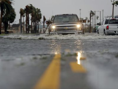 A drives moves through flood waters left behind by Hurricane Harvey, Saturday, Aug. 26, 2017, in Aransas Pass, Texas. (AP Photo/Eric Gay)