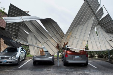 Cars are seen below a collapsed shelter following the passage of Hurricane Harvey on Aug. 26, 2017 in Galveston, Texas. (BRENDAN SMIALOWSKI/AFP/Getty Images)