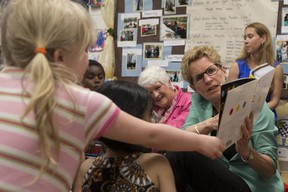 Ontario Premier Kathleen Wynne reads to a full-day kindergarten class in Guelph during the 2014 election campaign. (THE CANADIAN PRESS)