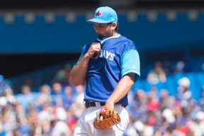 Toronto Blue Jays starting pitcher Joe Biagini reacts against the Minnesota Twins in Toronto on Sunday, August 27, 2017. (THE CANADIAN PRESS/Chris Young)