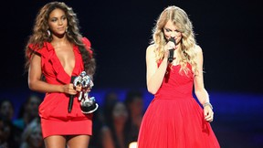 """Taylor Swift (R) speaks after Beyonce (L) allowed her to finish her speech, that was cut short by Kanye West, after Beyonce won """"Best Video of the Year"""" during the 2009 MTV Video Music Awards at Radio City Music Hall on Sept. 13, 2009 in New York City.  (Christopher Polk/Getty Images)"""