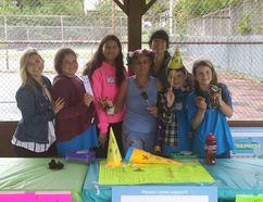 Selling at the Friday Gore Bay Outdoor Market, the Youth Enterprise Camp Headstart in Business, led by Kelly Mazzetti and Jennifer Marenger, with amazing students Willow Fogel, Jack Young, Cara Nahwegahbow and Ella Corbiere, stand with our Bonnie, who bought everything they were selling.