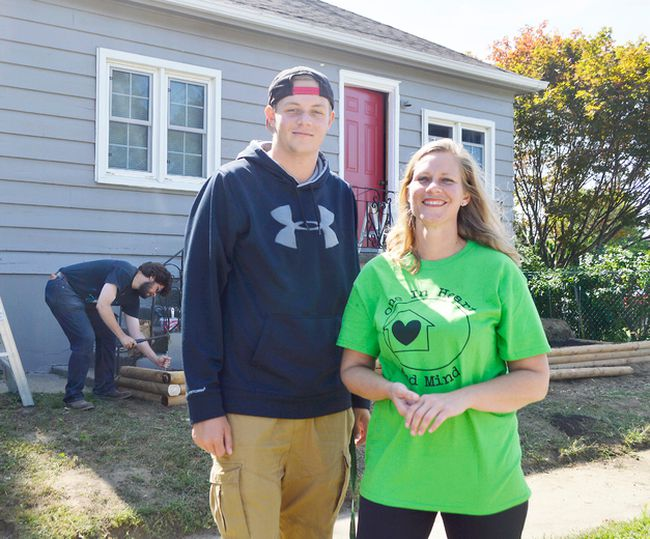 Jennifer Allossery and her son Riley Butler stand in front of their newly-renovated house. Dozens of volunteers helped restore the house on Aug. 25 and Aug. 26 as part of the 2017 Backyard Mission Project, a long-running annual event where volunteers come together to help people in Chatham-Kent.