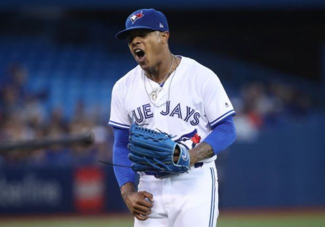 Marcus Stroman of the Toronto Blue Jays reacts after a throwing error by Raffy Lopez allowed an unearned run in the second inning during MLB game action against the Boston Red Sox at Rogers Centre on August 28, 2017 in Toronto. (Tom Szczerbowski/Getty Images)