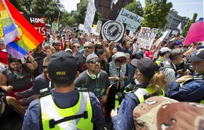 Counter-protesters scream at Pegida protesters behind a line of police outside of city hall in London, Ont. on Saturday August 26, 2017. More than 500 people counter-protested approximately 30 supporters of Pegida Canada (Patriots of Canada against the Islamization of the West). (Derek Ruttan/The London Free Press)